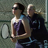 Legacy's no. 1 doubles players  Muriel Westover, left, and Molly Madson prepare for the serve from Ft. Collins doubles team of Katie Dugan and Andrea Raab during their match on Thursday at Legacy.<br /> <br /> April 1, 2011<br /> staff photo/David R. Jennings