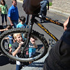 Jonah Cox, 11, waits to grab a bicycle while helping unload a semi truck from Ball Corp. with 5,000 cubic feet of sports equipment for the Jessica Redfield Ghawi giveSports Scholarship Fund at A Precious Child on Saturday.<br /> September 8, 2012<br /> staff photo/ David R. Jennings