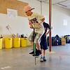 Zane Zinicola, 10, takes a break to try out a donated pogo stick while helping unload a semi truck from Ball Corp. with 5,000 cubic feet of sports equipment for the Jessica Redfield Ghawi giveSports Scholarship Fund at A Precious Child on Saturday.<br /> September 8, 2012<br /> staff photo/ David R. Jennings