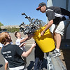 Tom Cappelletti, right, hands over a bin full of golf clubs while unloading a semi truck from Ball Corp. with 5,000 cubic feet of sports equipment for the Jessica Redfield Ghawi giveSports Scholarship Fund at A Precious Child on Saturday.<br /> September 8, 2012<br /> staff photo/ David R. Jennings