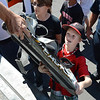 Charlie Cappelletti, 10, grabs a bag of sports gear while helping unload a semi truck from Ball Corp. with 5,000 cubic feet of sports equipment for the Jessica Redfield Ghawi giveSports Scholarship Fund at A Precious Child on Saturday.<br /> September 8, 2012<br /> staff photo/ David R. Jennings