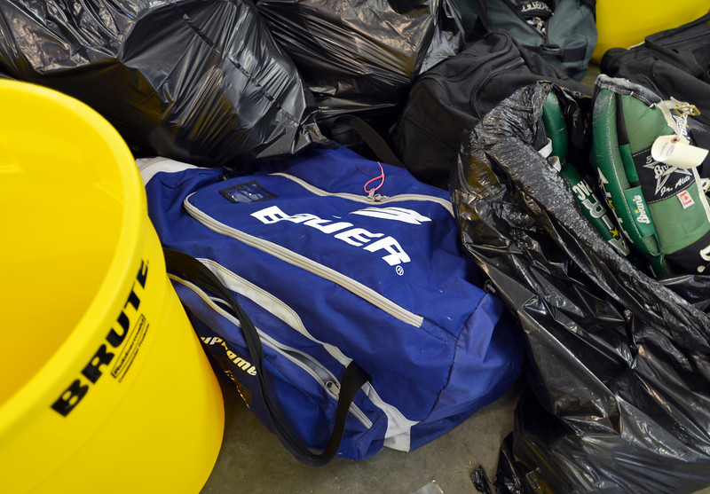 The blue  hockey equipment bag belonging to Jessica Redfield Ghawi while other hockey gear unloaded from a Ball Corp. semi truck with 5,000 cubic feet of sports equipment for the Jessica Redfield Ghawi giveSports Scholarship Fund at A Precious Child on Saturday.<br /> September 8, 2012<br /> staff photo/ David R. Jennings