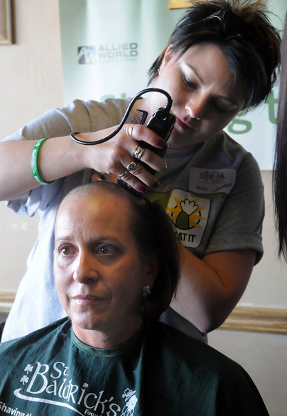 Cancer patient Carol Peterson has her hair shaved off by beautician Meta Eaton during the St. Baldrick's Foundation fundraiser at Papa Frank's  Restaurant on Saturday. <br /> <br /> March 20, 2010<br /> Staff photo/David R. Jennings