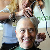 Sam Maroney has her hair shaved off by Christina Dolores during the St. Baldrick's Foundation fundraiser at Papa Frank's  Restaurant on Saturday. Over $11,000 was raised for pediatric cancer research.<br /> <br /> March 20, 2010<br /> Staff photo/David R. Jennings