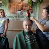 Joe Fabiano, 15, head is shaved by Maggie Dolores while Christina Ralston watches during the St. Baldrick's Foundation fundraiser at Papa Frank's  Restaurant on Saturday. Over $11,000 was raised for pediatric cancer research.<br /> <br /> March 20, 2010<br /> Staff photo/David R. Jennings