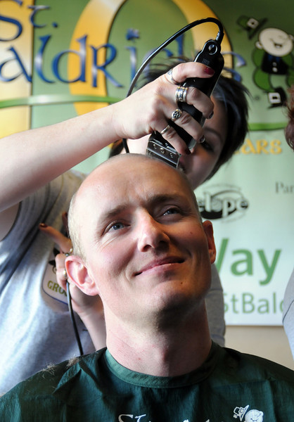 Sune Gravesen smiles as his hair is shaved off by Meta Eaton during the St. Baldrick's Foundation fundraiser at Papa Frank's  Restaurant on Saturday. <br /> <br /> March 20, 2010<br /> Staff photo/David R. Jennings