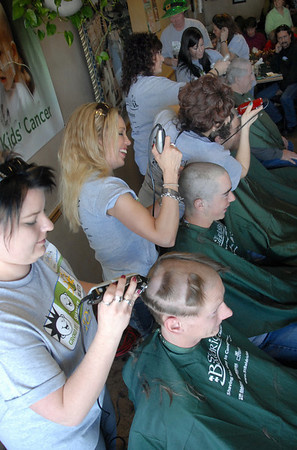 Beauticians shave the hair off of volunteers during the St. Baldrick's Foundation fundraiser at Papa Frank's  Restaurant on Saturday. Over $11,000 was raised for pediatric cancer research.<br /> <br /> March 20, 2010<br /> Staff photo/David R. Jennings