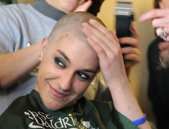 Jessica Hanson, 18,  feels her head after her hair was shaved off by her mother Linda Hanson during the St. Baldrick's Foundation fundraiser at Papa Frank's  Restaurant on Saturday. <br /> March 20, 2010<br /> Staff photo/David R. Jennings