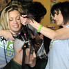 Candice Thurston has her hair is shaved off by Christina Ralston, left,  and Barb Guerrieri during the St. Baldrick's Foundation fundraiser at Papa Frank's  Restaurant on Saturday. Thurston's hair was donated to Lock of Love to make wigs for cancer patients.<br /> <br /> March 20, 2010<br /> Staff photo/David R. Jennings