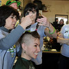 Susie Ritchey head is shaved by Linda Hanson and Barb Guerrieri while Susie's grandmother Dorothy Rizzi watches during the St. Baldrick's Foundation fundraiser at Papa Frank's  Restaurant on Saturday. Ritchey raised over $1903 also her hair was donated to the Locks of Love to make wigs for cancer patients. Over $11,000 was raised by Papa Frank's for pediatric cancer research.<br /> <br /> <br /> March 20, 2010<br /> Staff photo/David R. Jennings