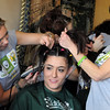 Candice Thurston has her hair is shaved off by Christina Ralston, left,  and Barb Guerrieri during the St. Baldrick's Foundation fundraiser at Papa Frank's  Restaurant on Saturday. <br /> <br /> March 20, 2010<br /> Staff photo/David R. Jennings
