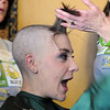 Jessica Hanson, 18, reacts as the last part of her hair is about to be shaved off by her mother Linda Hanson during the St. Baldrick's Foundation fundraiser at Papa Frank's  Restaurant on Saturday. <br /> <br /> March 20, 2010<br /> Staff photo/David R. Jennings