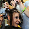 Jessica Hanson, 18,  hair is shaved off by her mother Linda Hanson, left, with the help of Bard Guerrieri during the St. Baldrick's Foundation fundraiser at Papa Frank's  Restaurant on Saturday. Over $11,000 was raised for pediatric cancer research. Jessica's hair was donated to Lock of Love to make wigs for cancer patients.<br /> <br /> March 20, 2010<br /> Staff photo/David R. Jennings