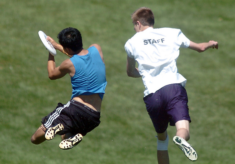 "Jeffery Lou, left,  ""Sleeveless"", catches the frisbee to score during the Grass Roots Ultimate Frisbee tournament at Broomfield County Commons Park on Saturday.<br /> August 21, 2010<br /> staff photo/David R. Jennings"