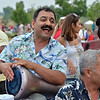 Bagher Whaddi plays a traditional Iranian drum while singing with his family Broomfield's Great American Picnic at the Broomfield County Commons Park on Wednesday. Whaddi just came from Iran to live in the United States and is celebrating his first Fourth of July.<br /> <br /> JJuly 4, 2012<br /> staff photo/ David R. Jennings