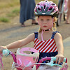 Lynzee Crouse, 4, rides her bicycle in the Nike Parade during Broomfield's Great American Picnic at the Broomfield County Commons Park on Wednesday.<br /> <br /> JJuly 4, 2012<br /> staff photo/ David R. Jennings