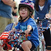 Molly Merrigan, 4, is ready to ride in the Bike Parade during Broomfield's Great American Picnic at the Broomfield County Commons Park on Wednesday.<br /> <br /> July 4, 2012<br /> staff photo/ David R. Jennings