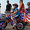 Rowan Snyder, 4 1/2, rides his bicycle in the Bike Parade during Broomfield's Great American Picnic at the Broomfield County Commons Park on Wednesday.<br /> <br /> JJuly 4, 2012<br /> staff photo/ David R. Jennings