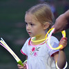 Kylee Claybaugh, 4, gives glow sticks to other children before the fireworks display duringBroomfield's Great American Picnic at the Broomfield County Commons Park on Wednesday.<br /> <br /> JJuly 4, 2012<br /> staff photo/ David R. Jennings