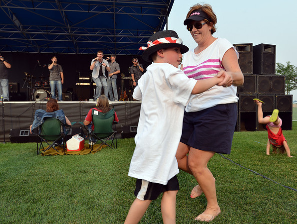 Natalie Schaan dances with her son Joseph, 7, to the music of FACE at Broomfield's Great American Picnic at the Broomfield County Commons Park on Wednesday.<br /> <br /> <br /> JJuly 4, 2012<br /> staff photo/ David R. Jennings
