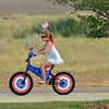 """Leah Abeyta, 8, rides her bicycle in the Bike Parade at Broomfield's Great American Picnic at Community Park on Wednesday.<br /> <br /> July 4, 2012<br /> staff photo/ David R. Jennings<br /> <br /> More photos and video please go to <br />  <a href=""""http://www.broomfieldenterprise.com"""">http://www.broomfieldenterprise.com</a>"""