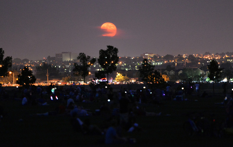 The full moon rises as the fireworks display is nearly over at  Broomfield's Great American Picnic at the Broomfield County Commons Park on Wednesday.<br /> <br /> JJuly 4, 2012<br /> staff photo/ David R. Jennings
