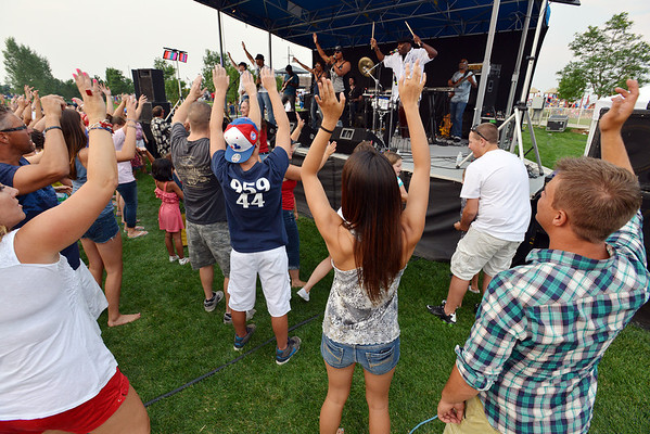 The crowd raises their arms to the music of Soul School during Broomfield's Great American Picnic at the Broomfield County Commons Park on Wednesday.<br /> <br /> JJuly 4, 2012<br /> staff photo/ David R. Jennings