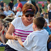 Natalie Schaan dances with her son Joseph, 7, to the music of FACE at Broomfield's Great American Picnic at the Broomfield County Commons Park on Wednesday.<br /> <br /> JJuly 4, 2012<br /> staff photo/ David R. Jennings