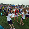 Heather Rider, center, dances with her daughters Aria, 8, left, and Addison, 14, to the music of Soul School during Broomfield's Great American Picnic at the Broomfield County Commons Park on Wednesday.<br /> <br /> JJuly 4, 2012<br /> staff photo/ David R. Jennings