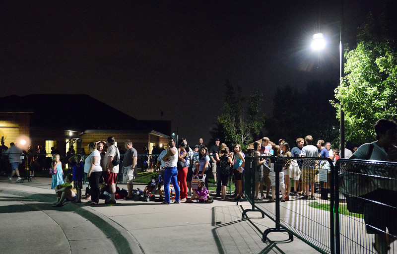 people wait in line to catch the shuttle to their cars parked at Legacy High School after  Broomfield's Great American Picnic at the Broomfield County Commons Park on Wednesday. <br /> <br /> JJuly 4, 2012<br /> staff photo/ David R. Jennings