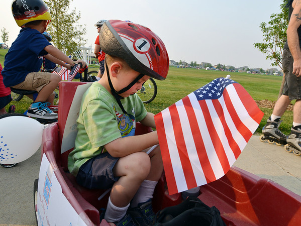 Liam Abrams, 4, waits in his red wagon for the Bike Parade to begin during Broomfield's Great American Picnic at the Broomfield County Commons Park on Wednesday.<br /> <br /> JJuly 4, 2012<br /> staff photo/ David R. Jennings