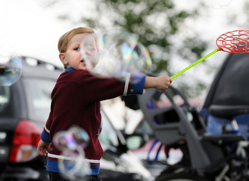 Liam Pearson, 3 1/2, makes bubbles during the Great American Picnic at Broomfield County Commons on Sunday.  The fireworks show was canceled due to the severe weather.<br /> <br /> <br /> July 4, 2010<br /> Staff photo/ David R. Jennings