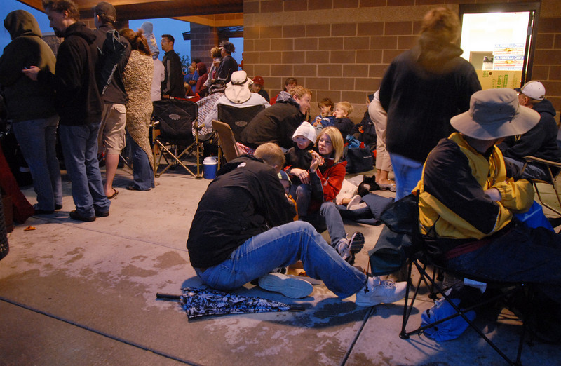 People take shelter during a downpour while waiting for the fireworks display at the Great American Picnic at Broomfield County Commons on Sunday.  The fireworks show was later canceled due to the severe weather.<br /> <br /> <br /> July 4, 2010<br /> Staff photo/ David R. Jennings