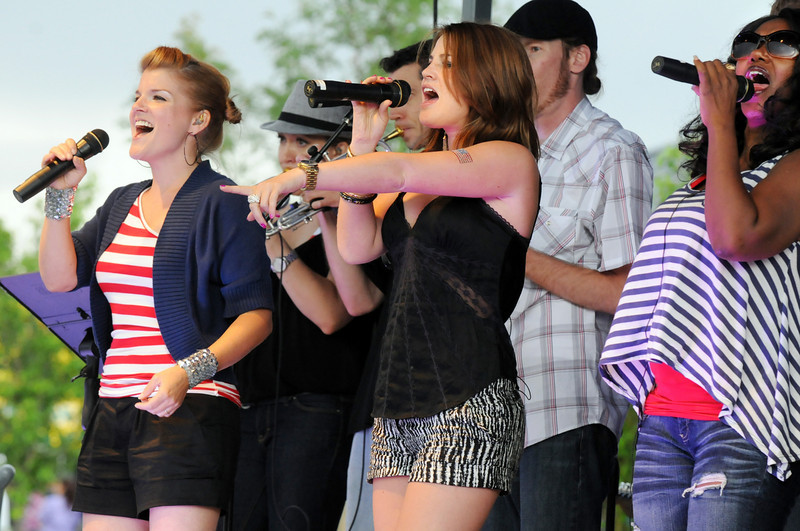 Funkiphino vocalists Valerie Rick, left, Brittany Loan and Antoinette Jackson perform during Broomfield's Great American Picnic at Broomfield County Commons on Sunday.  The fireworks show was canceled due to the severe weather.<br /> <br /> <br /> July 4, 2010<br /> Staff photo/ David R. Jennings