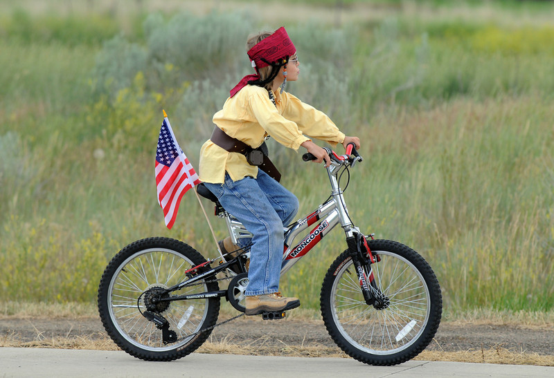 B<br /> Harlan Archer, 8, dressed as a pirate-mountain man for the bike parade at Broomfield's Great American Picnic at Broomfield County Commons on Sunday.  The fireworks show was canceled due to the severe weather.<br /> <br /> <br /> July 4, 2010<br /> Staff photo/ David R. Jennings