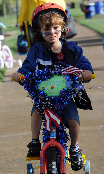 Samuel Cardona, 5, rides his bicycle during the bike parade at Broomfield's Great American Picnic at Broomfield County Commons on Sunday.  <br /> <br /> July 4, 2010<br /> Staff photo/ David R. Jennings