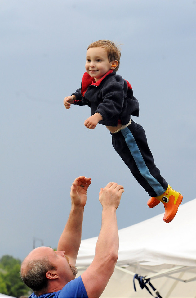 Shane Frahm, 2, is tossed in the air by his father Christian during the Broomfield's Great American Picnic at Broomfield County Commons on Sunday.  The fireworks show was canceled due to the severe weather.<br /> <br /> <br /> July 4, 2010<br /> Staff photo/ David R. Jennings