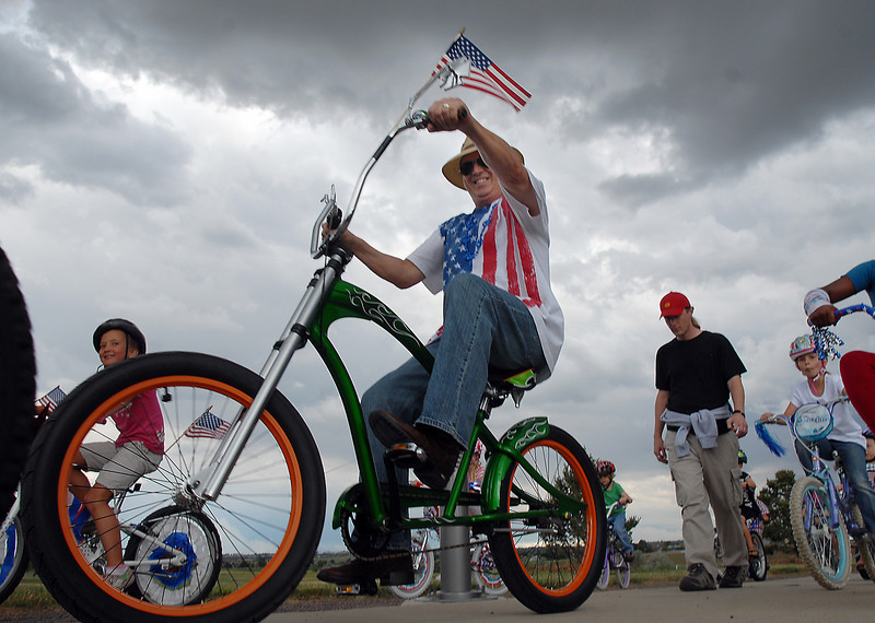 Greg Pringle rides his big bike during the bike parade at Broomfield's Great American Picnic at Broomfield County Commons on Sunday.  <br /> <br /> <br /> July 4, 2010<br /> Staff photo/ David R. Jennings