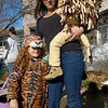 Callie Ferrell, 5, Tanya Ferrell and Sam Ferrell at the Great Pumpkin Festival at the Broomfield Community Center on Saturday.<br /> October 31, 2009<br /> Staff /Dylan Otto Krider
