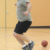 Brian Norcross jumps over a pumpkin during the Great Pumpkin Workout on Wednesday at the Derda Recreation Center.<br /> October 26, 2011<br /> staff photo/ David R. Jennings