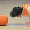 Dawn Keating does push-ups with a pumpkin at her head during the Great Pumpkin Workout on Wednesday at the Derda Recreation Center.<br /> October 26, 2011<br /> staff photo/ David R. Jennings