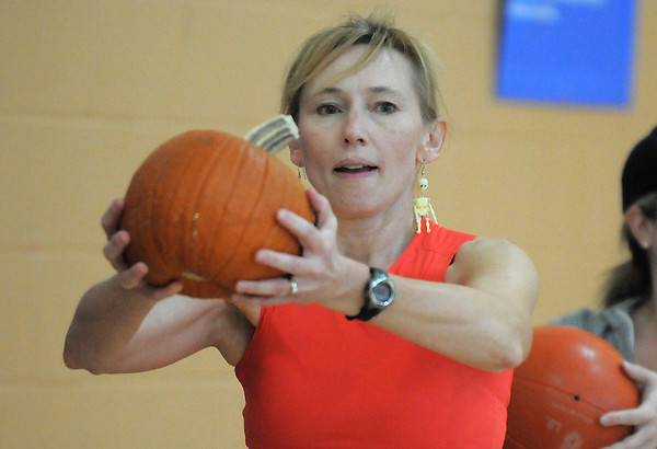 Karen Hopley holds a pumpkin while walking around the gym during the Great Pumpkin Workout on Wednesday at the Derda Recreation Center.<br /> October 26, 2011<br /> staff photo/ David R. Jennings