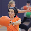 Dawn Keating uses a pumpkin during the Great Pumpkin Workout on Wednesday at the Derda Recreation Center.<br /> October 26, 2011<br /> staff photo/ David R. Jennings