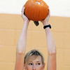 Karen Hopley holds a pumpkin over her head while exercising during the Great Pumpkin Workout on Wednesday at the Derda Recreation Center.<br /> October 26, 2011<br /> staff photo/ David R. Jennings