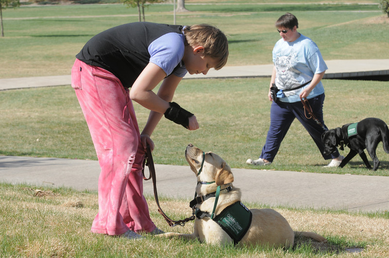 Anna Nicodemus, 11, gives a command to Keena during a Guide Dogs for the Blind, puppy in training demonstration at Community Park.<br /> <br /> April 6, 2012 <br /> staff photo/ David R. Jennings