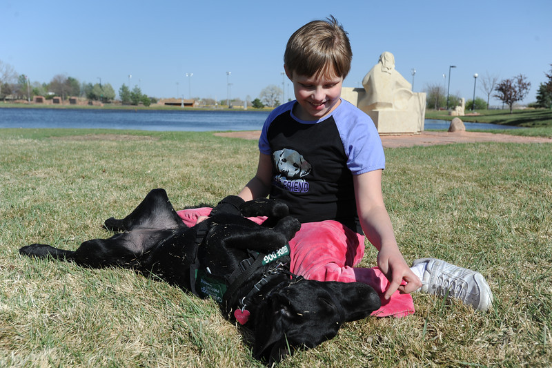 Anna Nicodemus, 11, plays with Bonita during a Guide Dogs for the Blind, puppy in training demonstration at Community Park.<br /> April 6, 2012 <br /> staff photo/ David R. Jennings