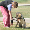 Anna Nicodemus, 11, gives Keena an order during Guide Dogs for the Blind, puppy in training demonstration at Community Park.<br /> <br /> April 6, 2012 <br /> staff photo/ David R. Jennings