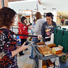 Kim Campbell, manger of FlatIron Crossing, left,  helps serve breakfast to  customers waiting inline including Michelle Herrera, from Denver, who was first in line for the opening of the new H&M store on Thursday at FlatIron Crossing mall.<br /> August 23, 2012<br /> staff photo/ David R. Jennings