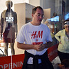 Chad Fogelberg wears his H&M t-shirt while waiting in line for the opening of the new H&M store on Thursday at FlatIron Crossing mall.<br /> August 23, 2012<br /> staff photo/ David R. Jennings