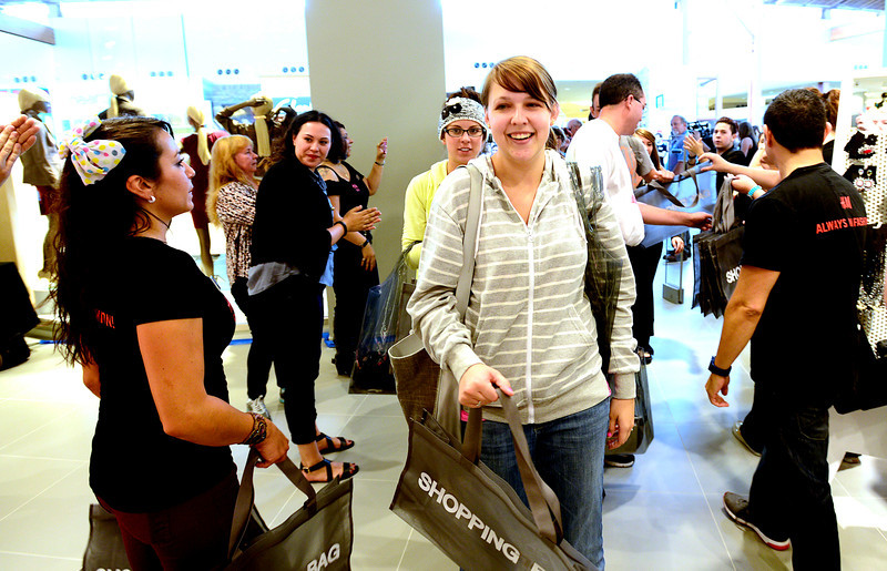 "0823HM2.jpg Baily Rodriguez is one of the first customers to enter the store during grand opening of the H&M store at Flatiron Crossing in Broomfield, Colorado August 23, 2012. BOULDER DAILY CAMERA/ Mark Leffingwell<br /> <br /> <br /> See video of shoppers at the new H&M store at  <a href=""http://www.dailycamera.com"">http://www.dailycamera.com</a>"